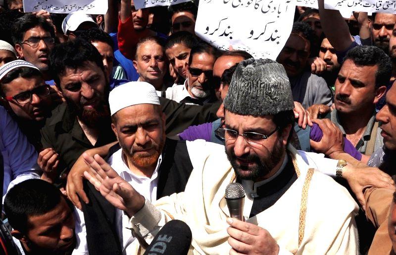 Hurriyat Conference leader Mirwaiz Umar Farooq leads a protest outside Jamia Masjid in Srinagar on May 5, 2017.