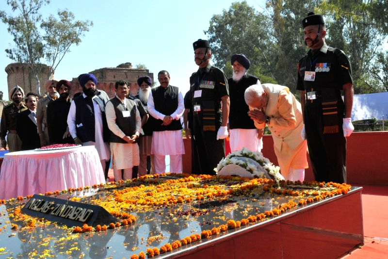 Prime Minister Narendra Modi pays homage to Shaheed Bhagat Singh, Rajguru and Sukhdev at National Martyrs Memorial, at Hussainiwala, in Punjab on March 23, 2015. Also seen Punjab Chief ... - Narendra Modi and Parkash Singh Badal