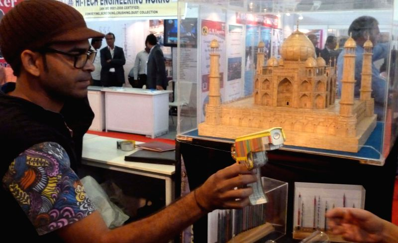 A book in the shape of a revolver on display during the Deck Expo in Hyderabad on Feb 13, 2015.