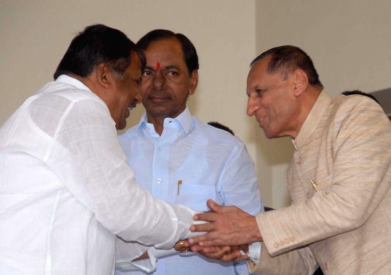A. Chandulal with Telangana Governor E.S.L. Narasimhan Rao and Chief Minister K Chandrasekhar Rao after swearing-in as a Telangana Minister in Hyderabad, on Dec 16, 2014. - K Chandrasekhar Rao and L. Narasimhan Rao