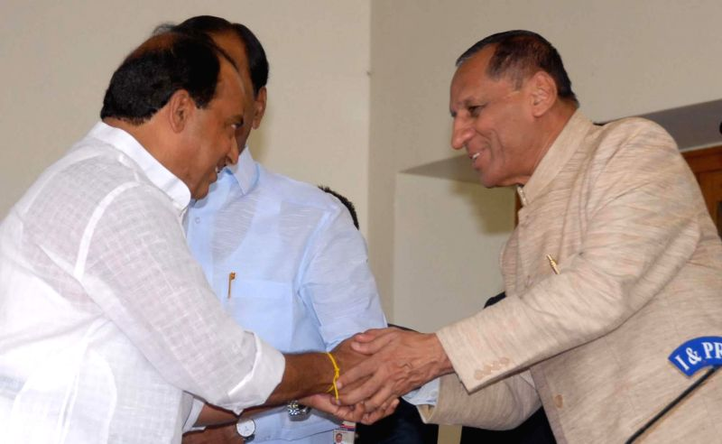 A. Indrakaran Reddy with Telangana Governor E.S.L. Narasimhan Rao after swearing-in as a Telangana Minister in Hyderabad, on Dec 16, 2014. - A. Indrakaran Reddy and L. Narasimhan Rao