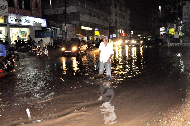 A man wades through waterlogged streets of Hyderabad on Nov 12, 2014.