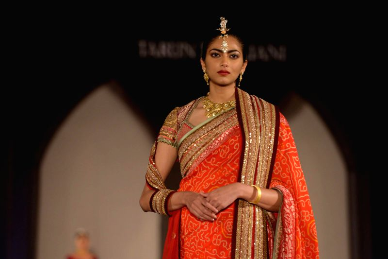 A model walks the ramp for fashion designer Tarun Tahiliani during a bridal jewellery fashion show organised in Hyderabad, on Jan 13, 2015.