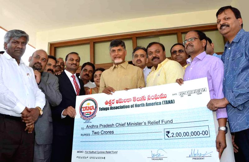 A TANA (Telugu Association of North America) delegation contributes towards the welfare of Hudhud victims to Andhra Pradesh Chief Minister N. Chandrababu Naidu in Hyderabad, on Dec 25, ... - N. Chandrababu Naidu