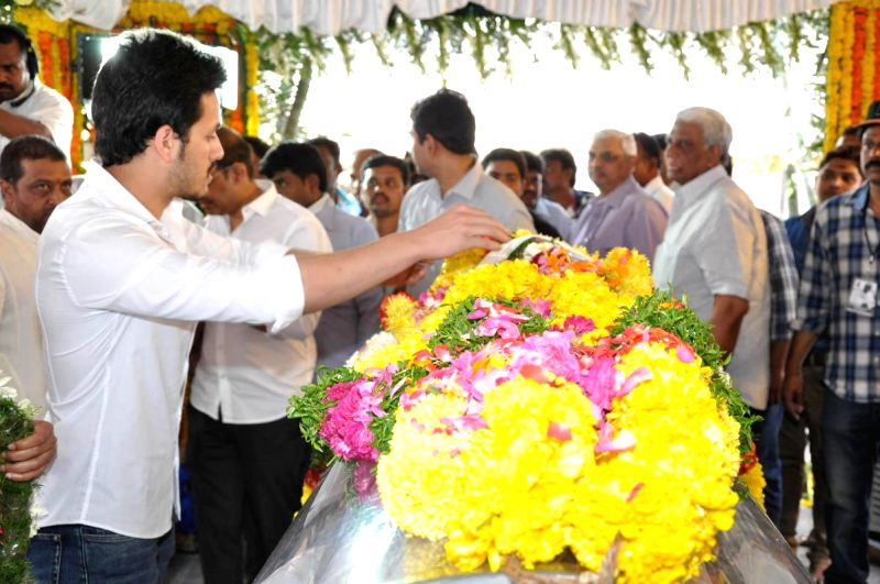 Actor Akhil Akkineni pays his last respect to multilingual Indian film producer Daggubati Ramanaidu (D Ramanaidu), who breathed his last on 18th Feb 2015 , in Hyderabad on Feb 19, 2015. - Akhil Akkineni