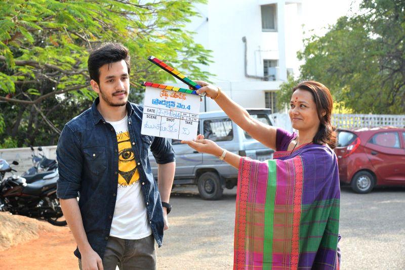 Actor Akkineni Nagarjuna's sons Akhil Akkineni with mother Amala Akkineni during the launch of his debut in a yet-untitled Telugu film in Hyderabad on Dec 17, 2014. - Akkineni Nagarjun