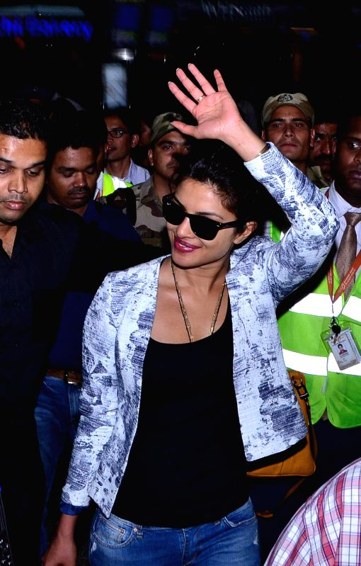 Actress Priyanka Chopra arrive at Shamshabad Airport to attend wedding ceremony of Salman`s sister in Hyderabad. - Priyanka Chopra