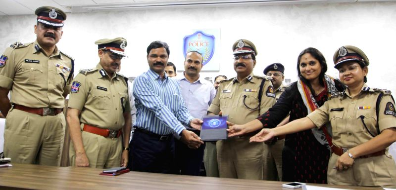 Additional DGP Sudeep Lakhtakia, Hyderabad Police Commissioner Mahender Reddy, Regional Passport Officer (RPO) for Hyderabad Ashwini Sattaru and others during a programme organised to ...