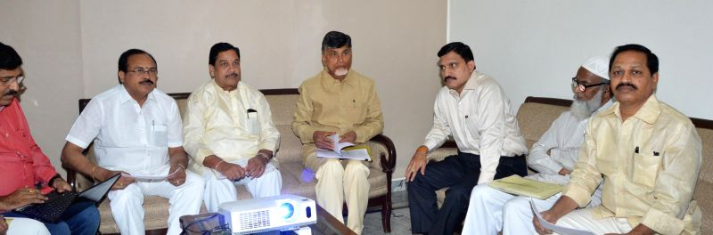 Andhra Pradesh Chief Minister and TDP chief N. Chandrababu Naidu and others during a meeting regarding party's membership drive in Hyderabad on Nov 30, 2014. - N. Chandrababu Naidu