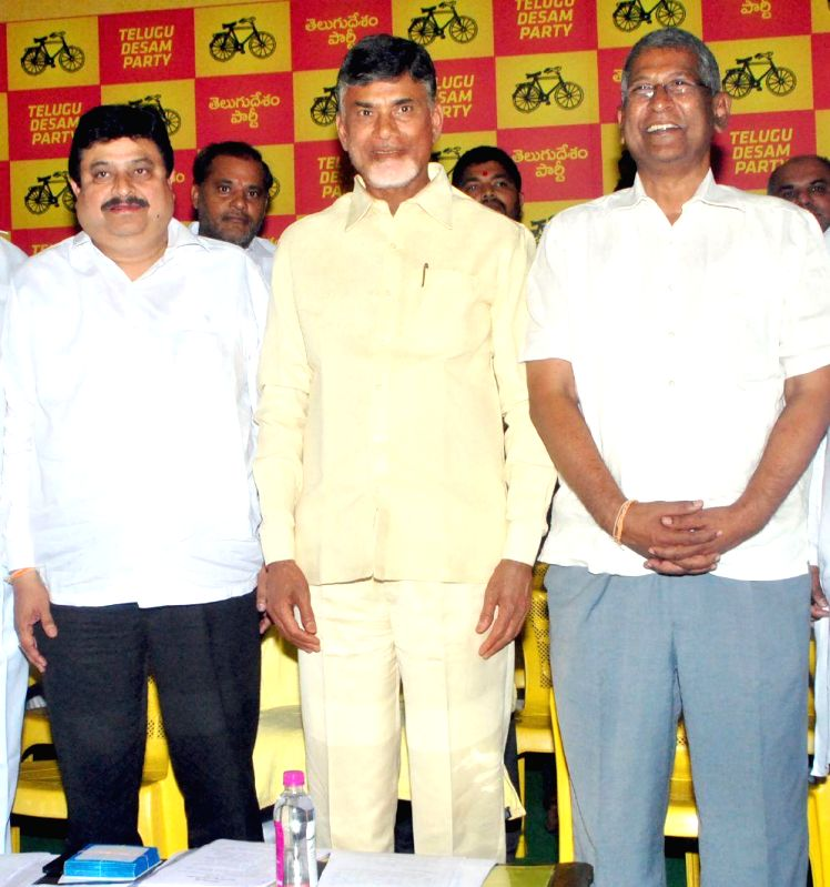 Andhra Pradesh Chief Minister N. Chandrababu Naidu and others during a programme in Hyderabad, on March 12, 2015. - N. Chandrababu Naidu