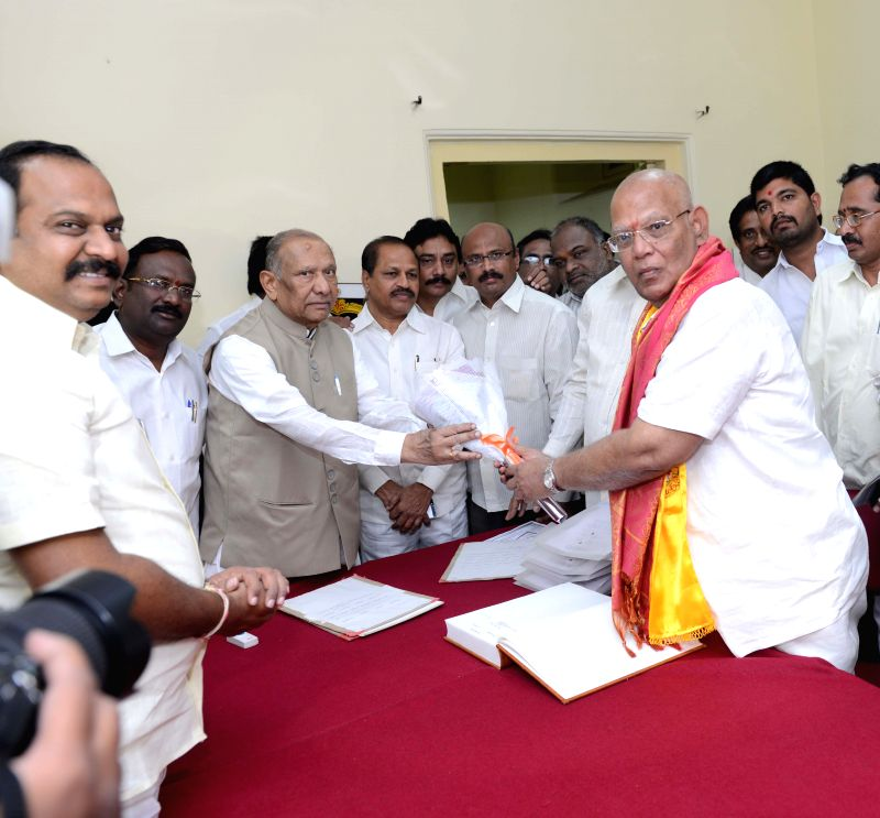 Andhra Pradesh Council Chairman A. Chakrapani administers oath of membership to V.V.V. Chowdary  in Hyderabad on March 30, 2015.
