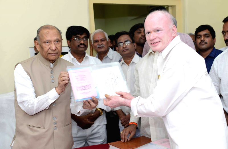 Andhra Pradesh Council Chairman A. Chakrapani administers oath of membership to P. Subhash Chandra Bose  in Hyderabad on March 30, 2015.