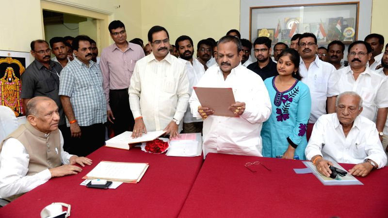 Andhra Pradesh Council Chairman A. Chakrapani administers oath of membership to K. Veerabhadraswamy  in Hyderabad on March 30, 2015.