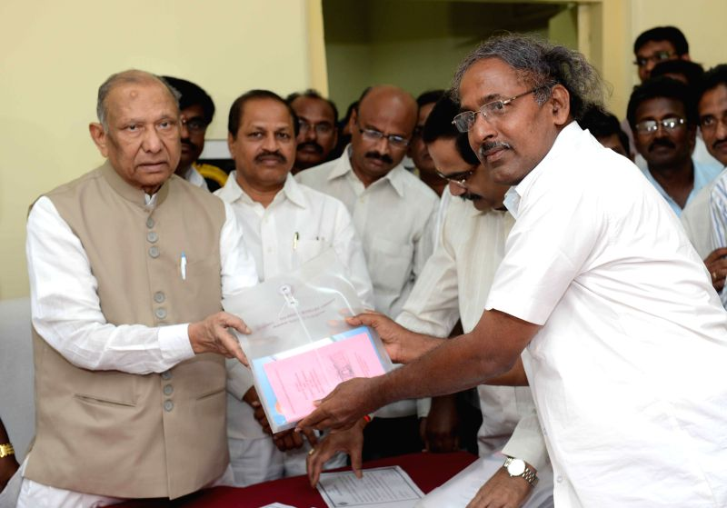 Andhra Pradesh Council Chairman A. Chakrapani administers oath of membership to A.S. Ramakrishna (Teachers` Constituency)  in Hyderabad on March 30, 2015.