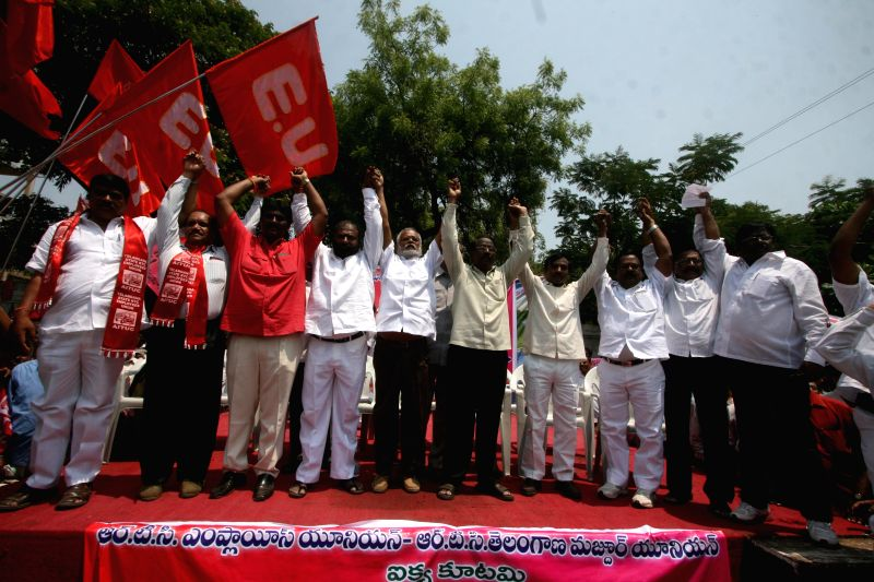 Andhra Pradesh State Road Transport Corporation employees stage a demonstration in Hyderabad on April 2, 2015.