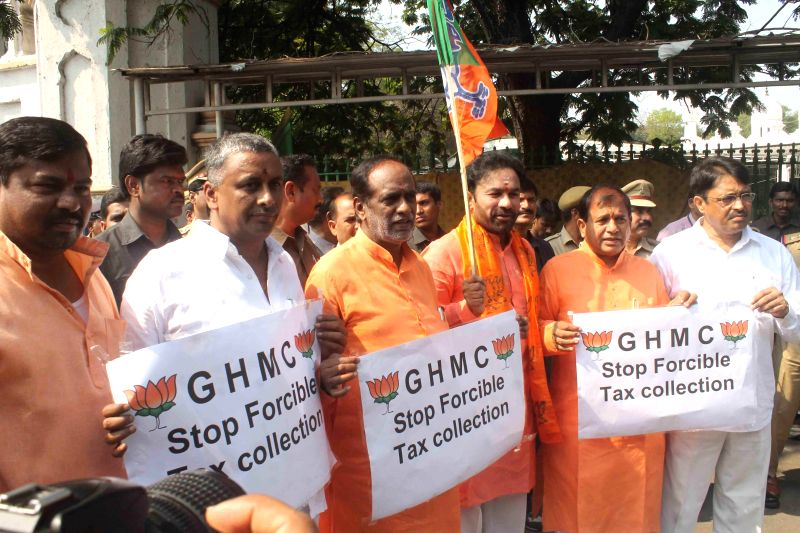 BJP legislators leg by Telangana BJP chief G. Kishan Reddy stage a demonstration to protest against GHMC for forcible collection of taxes in Hyderabad, on March 7, 2015. - G. Kishan Reddy