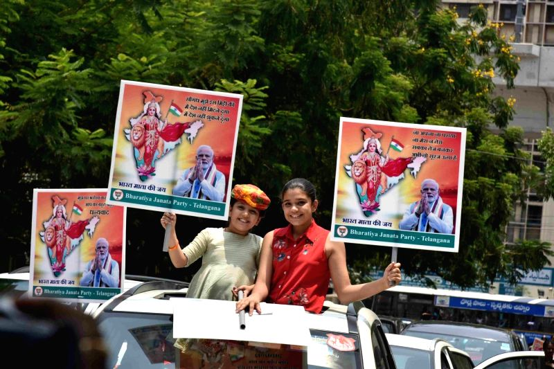 Hyderabad: BJP supporters celebrate after the party led by Prime Minister Narendra Modi appeared set to retain power as its candidates alone led in 294 of the 541 Lok Sabha seats with its allies faring equally well across the country, in Hyderabad on