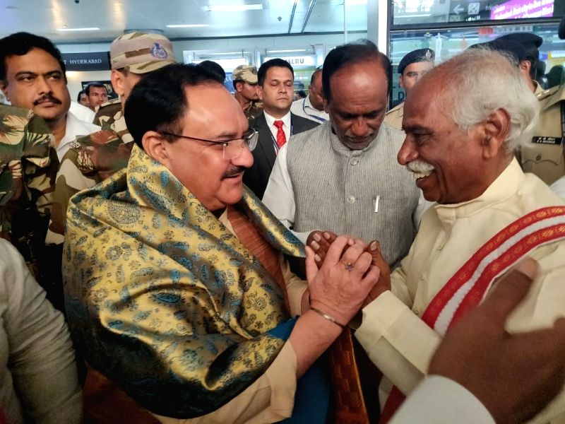 Hyderabad: BJP Working President JP Nadda being received by former Union Minister and party leader Bandaru Dattatreya at the Rajiv Gandhi International Airport in Hyderabad on Aug 18, 2019.