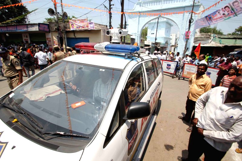 CC camera is being installed on the rooptop of a telangana police vehicle to monitor the rallies in Hyderabad on March 28, 2015.