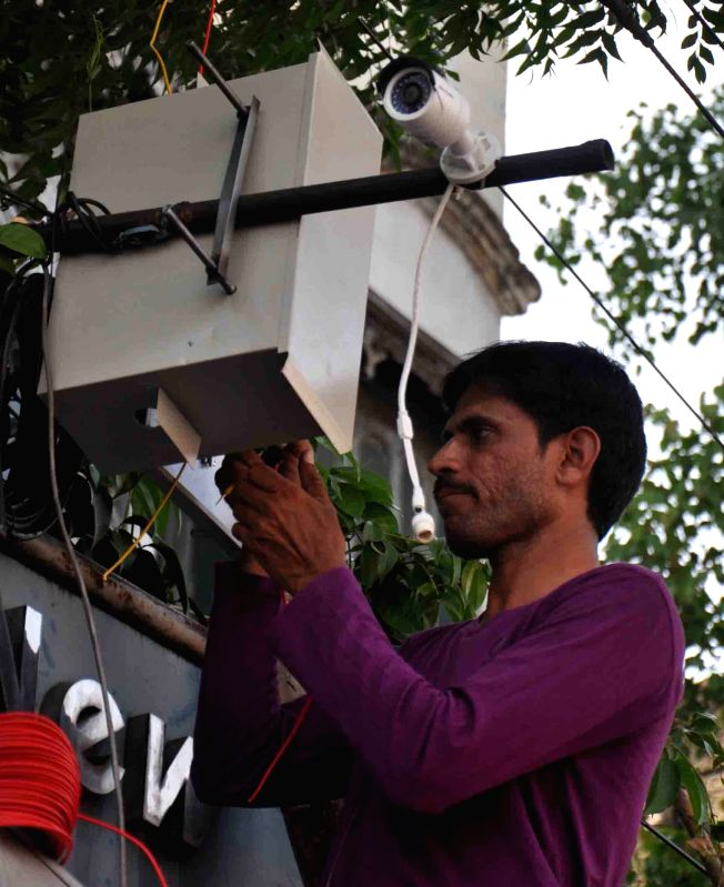 CCTV cameras being installed at strategic locations in Hyderabad on the eve of Hanuman Jayanti on April 3, 2015.