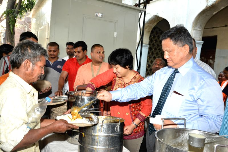 Chief Election Commissioner (CEC) HS Brahma distributes meals - under Greater Hyderabad Municipal Corporation's subsidised Rs.5 meal scheme for the poor - at Nampally of Hyderabad on Feb ..