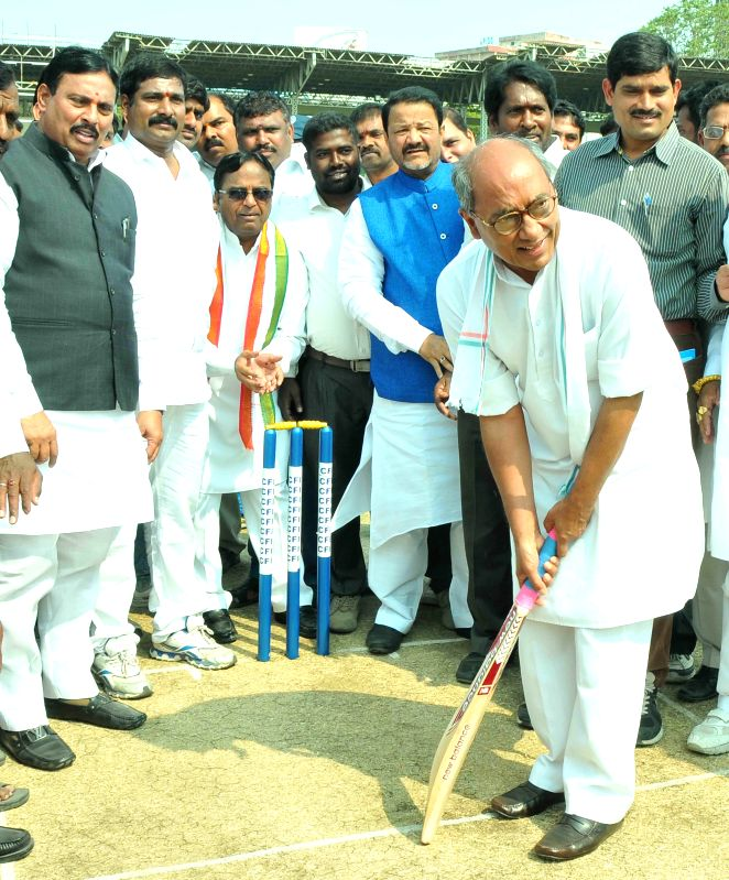 Congress general secretary Digvijaya Singh tries his hands at batting at the inauguration of 2nd Rajiv Gandhi International Cricket Tournament at  in Hyderabad, on Jan 20, 2015.