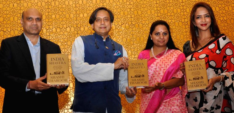 Congress leader and Thiruvananthapuram MP Shahi Tharoor with TRS MP K. Kavitha during a programme organised to launch his book `India Shastra` in Hyderabad, on March 30, 2015.