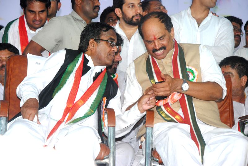 Congress leader Uttam Kumar Reddy takes over as Telangana Congress chief during a programme in Hyderabad, on March 8, 2015. Also seen party leader and former Telangana Congress chief ...