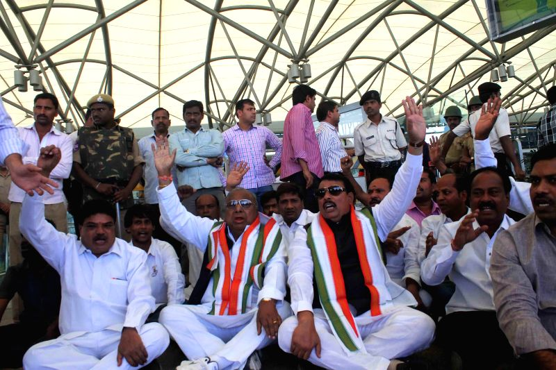 Congress leaders stage a demonstration against the central government's decision to rename the domestic terminal at Shamshabad airport as NT Rama Rao domestic terminal in Hyderabad, on .. - Rao