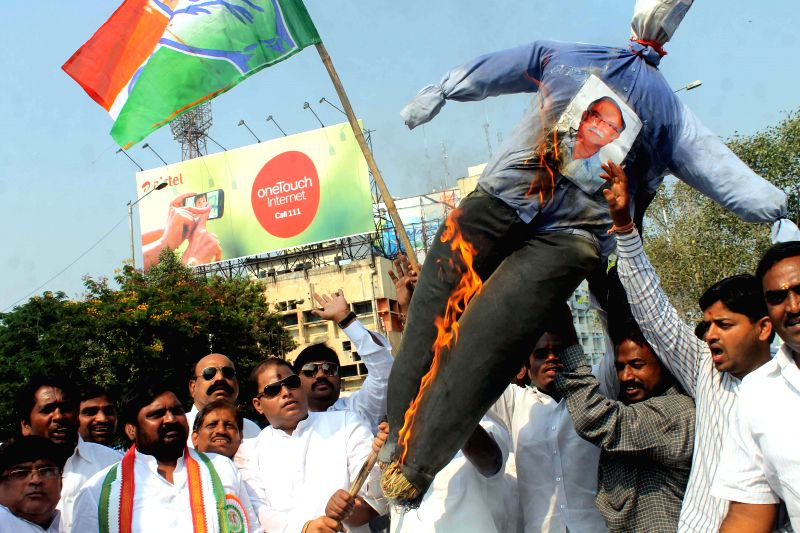Congress workers set fire an effigy of Civil Aviation Minister Ashok Gajapathi in a protest against the Centre`s decision to name the domestic terminal of Rajiv Gandhi International ... - T. Rama Rao