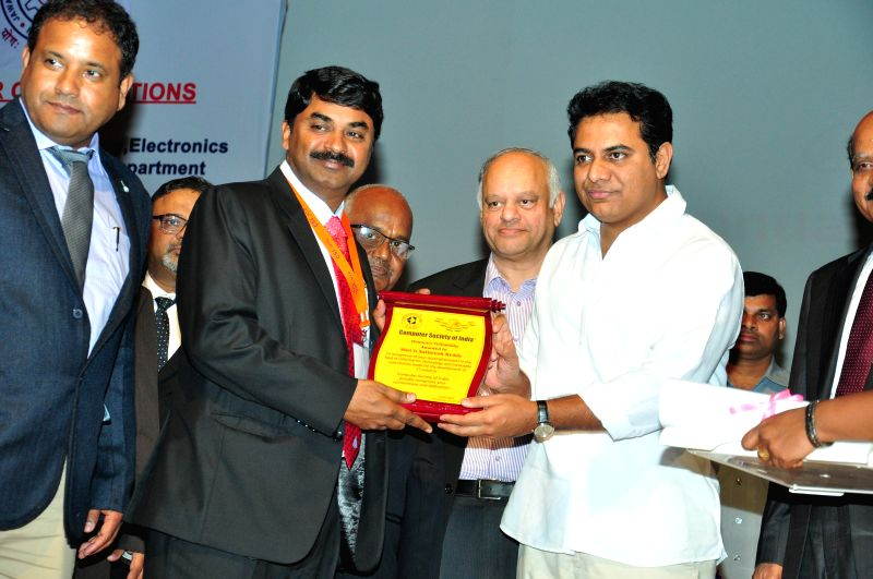 Distinguished Scientist & Director of RCI Dr G. Satheesh Reddy being conferred Honorary Fellowship of Computer Society of India by Telangana Minister for Information Technology K.T. ... - T. Rama Rao