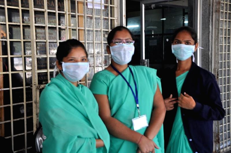 Gandhi Hospital staff wear masks to avoid contracting swine flu in Hyderabad, on Jan 20, 2015.