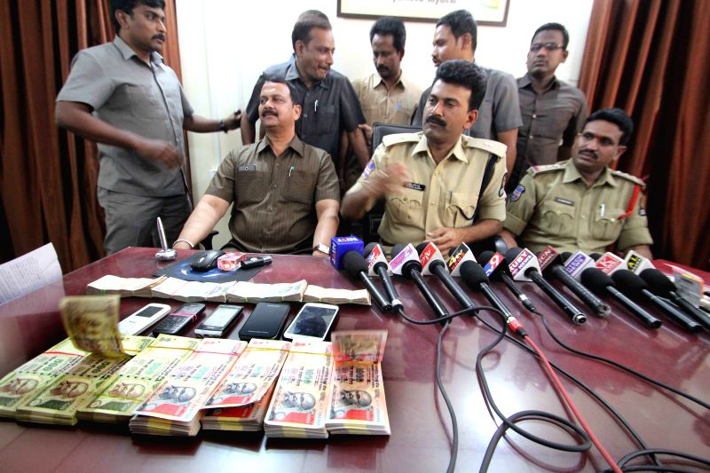Hyderabad Additional DCP (Task Force) N Koti Reddy during a press conference after a Hyderabad police team busted a counterfeit currency racket and arrested a gang of five in Hyderabad on ... - N Koti Reddy