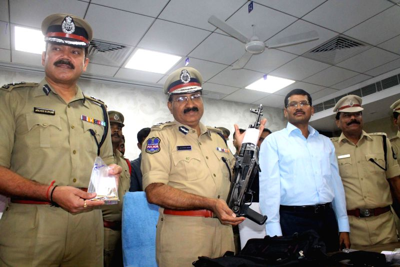 Hyderabad Police Commissioner Mahender Reddy displays the gun used in firing on Aurobindo Pharma director at KBR Park,  during a press conference in Hyderabad on Nov 21, 2014.