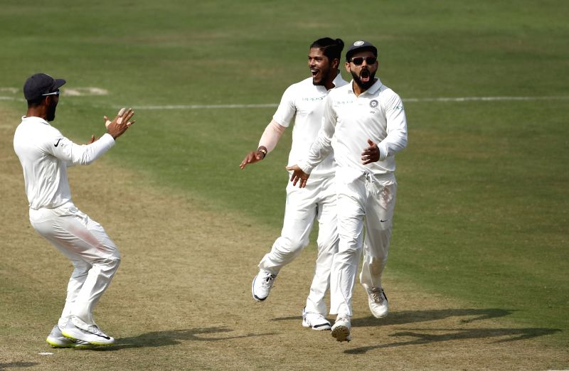 Hyderabad: India's Umesh Yadav and Virat Kohli celebrate the wicket of Shane Dowrich on Day 3 of the Second Test match between India and West Indies at Rajiv Gandhi International Stadium in Hyderabad on Oct 14, 2018. (Photo: Surjeet Yadav/IANS)