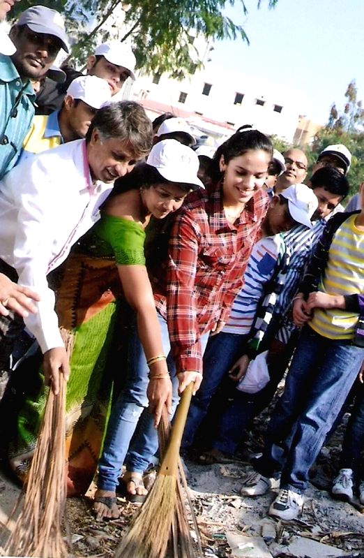Indian badminton player Saina Nehwal participates in Clean India Campaign in Hyderabad on Dec 25, 2014.