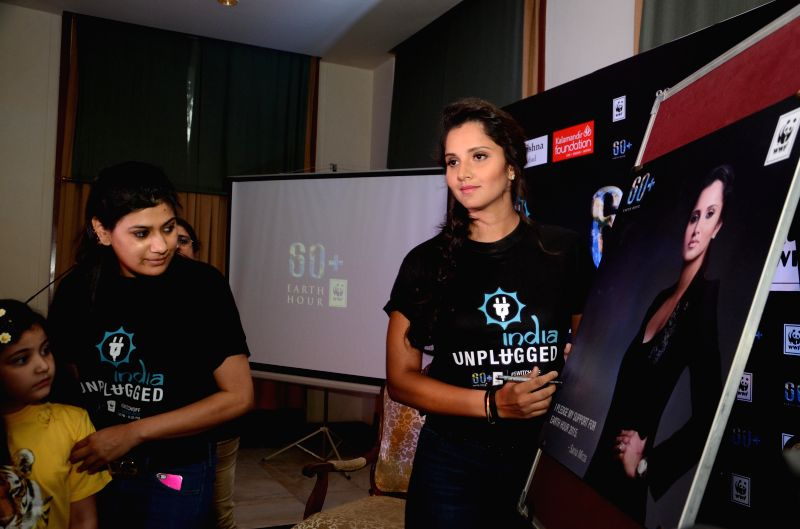 Indian tennis player Sania Mirza pledges her support for Earth Hour in Hyderabad on March 5, 2015.