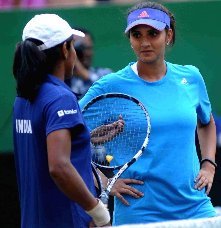 Indian tennis player Sania Mirza during a tennis match in Hyderabad, on April 15, 2015.