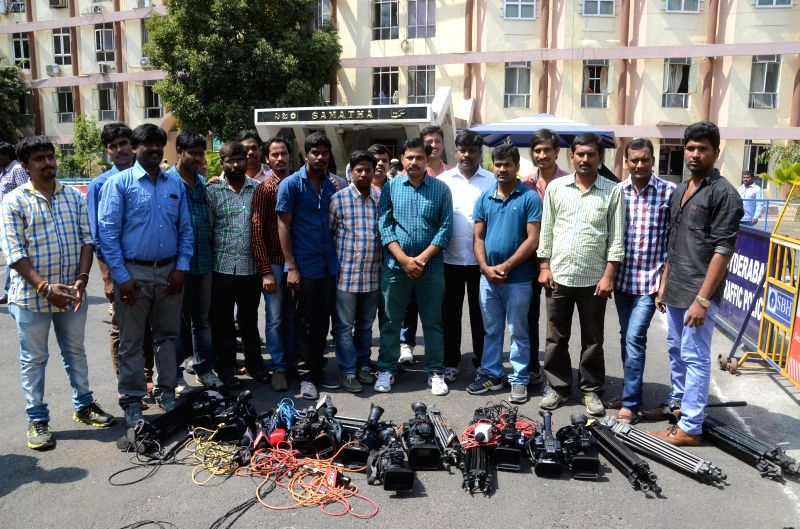 Journalists stage a demonstration outside the Telangana Secretariat after the news about Telangana government's intention to ban media entry into the secretariat spread in Hyderabad, on ...