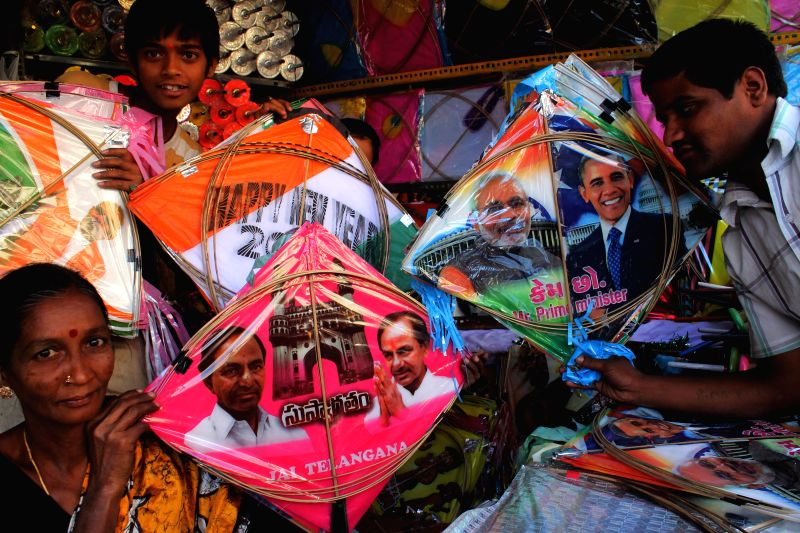 Kites with the photographs of Prime Minister Narendra Modi, US President Barack Obama and Telangana Chief Minister K Chandrasekhar Rao on sale at a Hyderabad shop ahead of Makar Sankranti . - Narendra Modi and K Chandrasekhar Rao