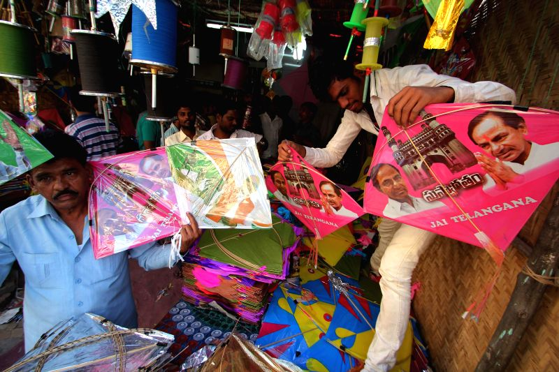 Kites with the photographs of Prime Minister Narendra Modi and Telangana Chief Minister K Chandrasekhar Rao on sale at a Hyderabad on Makar Sankranti in Hyderabad on Jan. 14, 2015. - Narendra Modi and K Chandrasekhar Rao