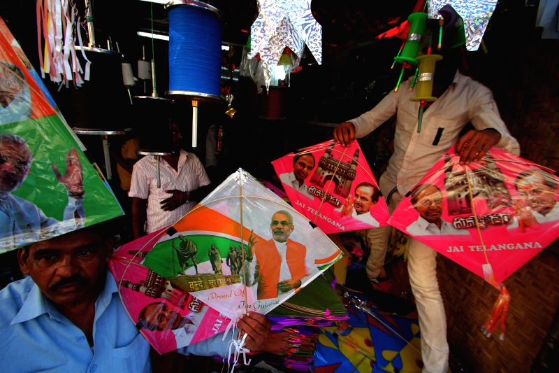 Kites with the photographs of Prime Minister Narendra Modi and Telangana Chief Minister K Chandrasekhar Rao​​ on sale at a Hyderabad on Makar Sankranti in Hyderabad on Jan. 14, 2015. - Narendra Modi and K Chandrasekhar Rao