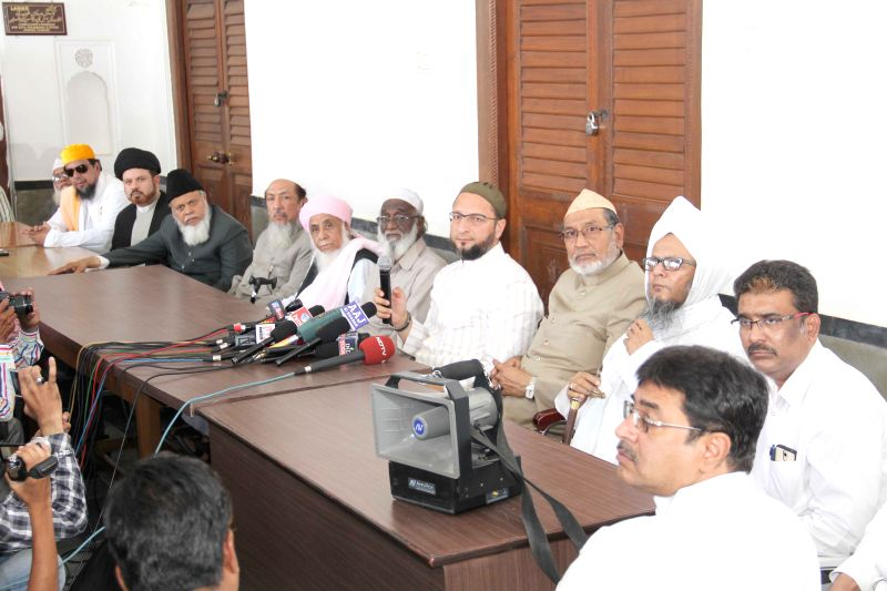 MIM chief Asaduddin Owaisi and religious leaders address press regarding the encounter of five terror accused in Warangal of Telangana; in Hyderabad on April 8, 2015.