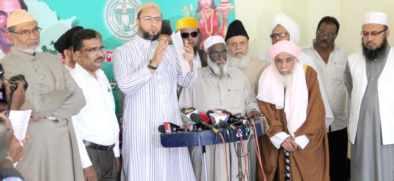 MIM chief Asaduddin Owaisi and religious leaders during a press conference in Hyderabad, on April 9, 2015.