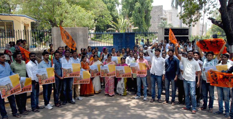 Osmania University students affiliated to ABVP stage a demonstration protest Telangana Chief Minister K Chandrasekhar Rao's plans to take over university land in Hyderabad, on May 21, ... - K Chandrasekhar Rao