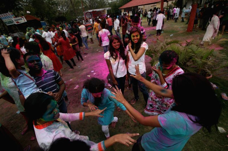 People celebrate Holi in Hyderabad on March 6, 2015.