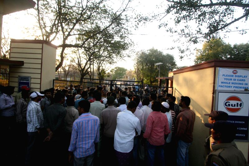 People gather outside the Kukatpally premises of Gulf Oil Corporation Limited company where two workers were killed and 12 others injured in an explosion, in Hyderabad, on Feb 23, 2015.