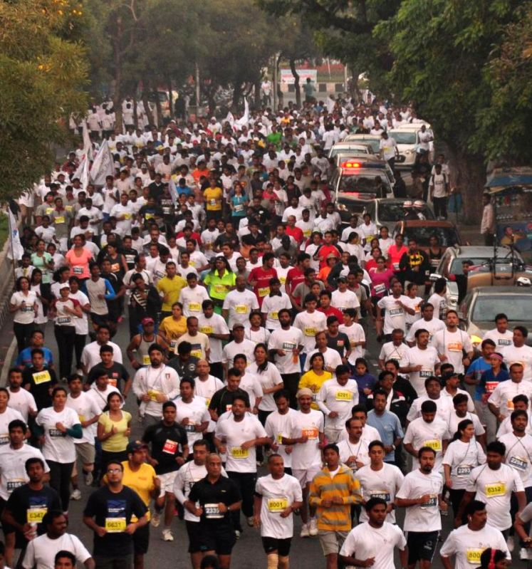 People participate in `Hyderabad 10 K Run` on Nov 30, 2014.