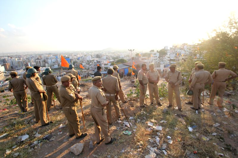 Police personnel deployed near a dargah in Hyderabad after two groups clashed following collapse of a wall on Dec 30, 2014.