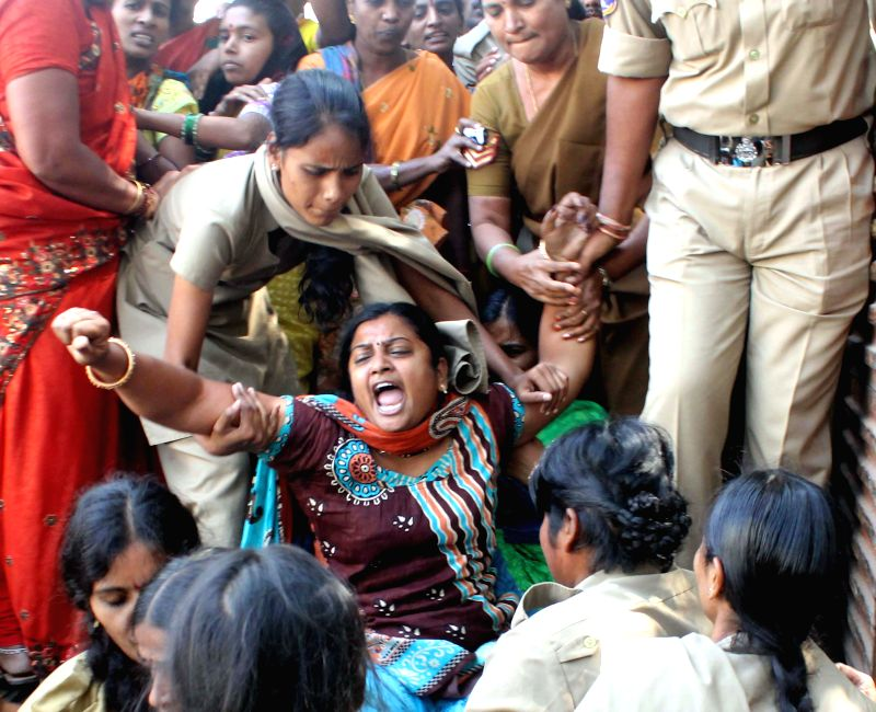 Police personnel remove teachers demonstrating to demand disbursal of their salaries pending for last 17 months in Hyderabad, on Nov 24, 2014.